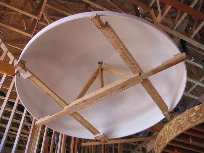 Dome is securely fastened to the cable and ready to hoist. - Recent 9' Ceiling Dome Installation